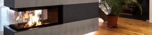Heizkamin als Raumteiler mit Betonverkleidung