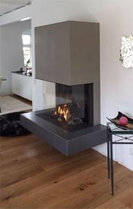 Gaskamin mit Haube und Feuertisch aus Beton